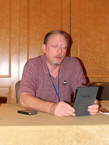 Giving a reading at Chicon, 2013.