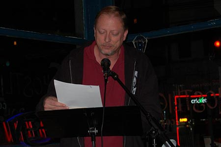 Reading at Ghost Light Coffee House, 2012.